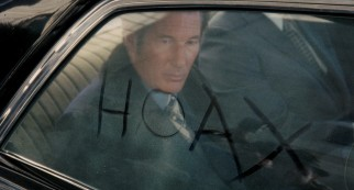 Clifford Irving (Richard Gere) writes a titular word on a car window that's disconcertingly dirty on the inside.