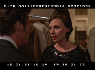 "The new ""Outtakes and Unused Clips"" reel includes alternate edits of scenes like this one, in which Irving consults publisher Andrea Tate (Hope Davis) at a masquerade ball."