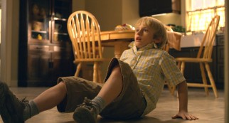Lucas (Nathan Gamble) is knocked back on his butt by fear.