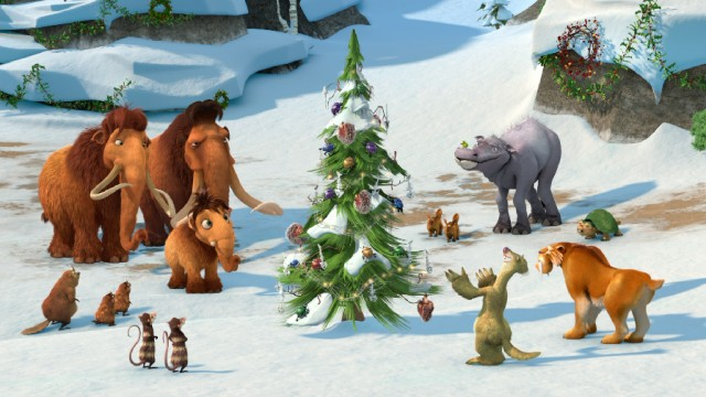 "The cast of ""Ice Age: A Mammoth Christmas Special"" admire the world's first Christmas tree, hastily and proudly decorated by Sid the sloth."