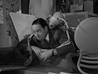 "On his self-guided tour of the Disney studio, Robert Benchley gets tackled by a skeleton in ""The Reluctant Dragon."""