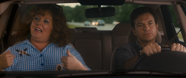 "Sandy Bigelow Patterson (Jason Bateman) finds himself having to drive cross-country with Diana (Melissa McCarthy), the woman who stole his identity and is now singing ""Milkshake."""