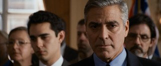 Governor Morris (George Clooney) receives a troubling phone call during a press conference.