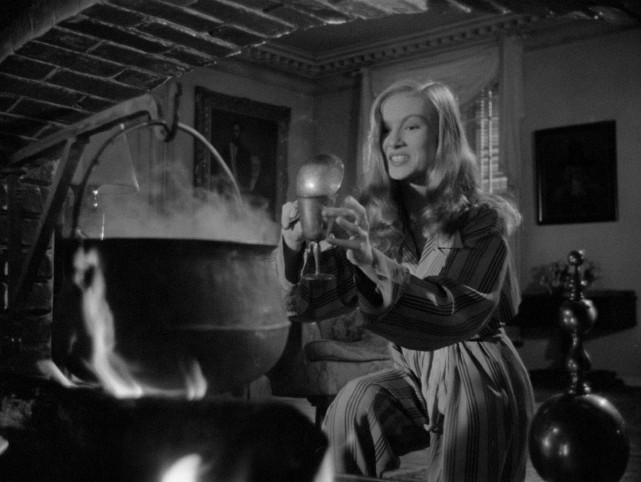 "Jennifer (Veronica Lake) bottles a freshly-brewed love portion she intends to use on her target in the 1942 comedy ""I Married a Witch."""