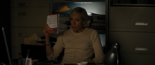 "Nate's gum-chewing supervisor at the FBI (Toni Collette) recommends ""How to Win Friends and Influence People"" as part of his undercover assignment."