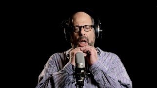 "Fred Melamed pulls at his jowl in one of six ""In a World..."" promos."