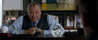 In one of his final film roles, James Gandolfini plays Doug Munny, the hotel owner who gives Burt and Anton their big break, and asks them to stay current.