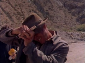 "Harrison Ford hopes that staples will keep his iconic hat from blowing away in ""The Making of 'The Last Crusade.'"""