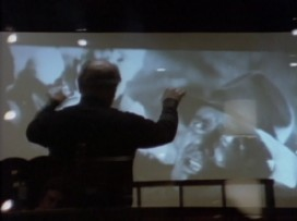 "John Williams conducts to the movie in ""The Music of Indiana Jones."""