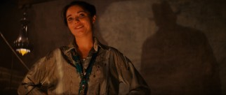 The only love interest to feature in more than one film, Marion Ravenwood (Karen Allen) is introduced next to Indiana Jones' iconic silhouette.
