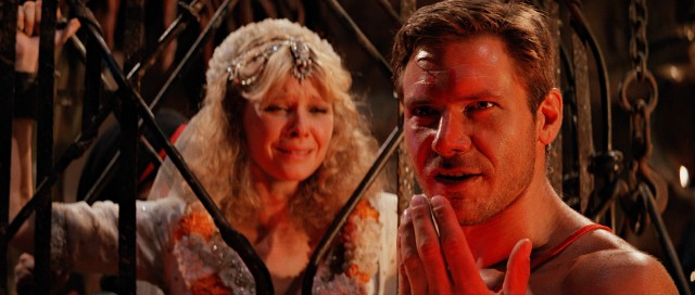"A supposedly brainwashed Indiana Jones (Harrison Ford) prepares to punish the whiney Willie Scott (Kate Capshaw) in ""Indiana Jones and the Temple of Doom."""