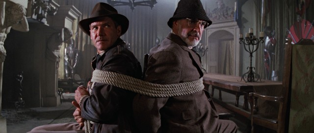 "Father (Sean Connery) and son (Harrison Ford) get a bit tied up by Nazis in ""Indiana Jones and the Last Crusade."""