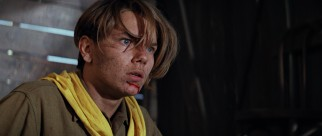 "The young Indiana Jones (River Phoenix) bloodies his chin in the prologue to ""The Last Crusade."""