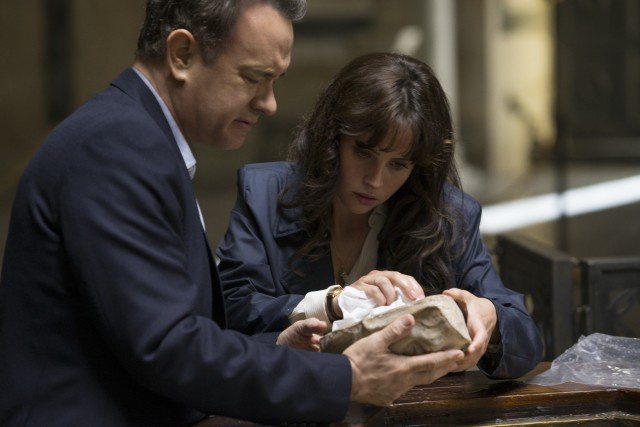 "Robert Langdon (Tom Hanks) and Sienna Brooks (Felicity Jones) take a look at the back of Dante's death mask in ""Inferno."""