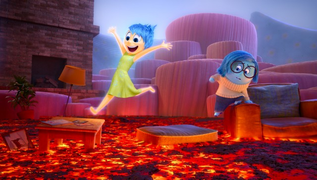 "Joy and Sadness navigate through fiery Imagination Land in Pixar's ""Inside Out."""