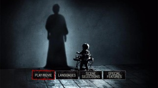 The widest of Insidious: Chapter 2's poster designs serves as the static main menu of the film's DVD and Blu-ray.