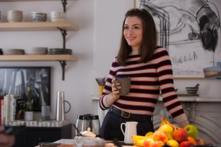 Anne Hathaway tries to juggle work and family as busy business owner Jules Ostin.