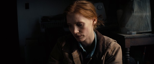 A grown-up Murph (Jessica Chastain) searches for answers in her childhood bedroom.