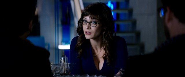 Lizzy Caplan plays Lacey, the CIA agent the guys suspect is honeypotting them to accept their assassination mission.