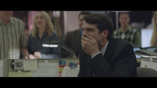 Timothy Simons tries to cover up his laughter in the gag reel.