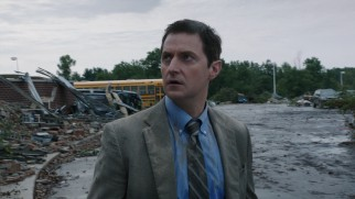 Vice Principal Gary Fuller (Richard Armitage) surveys the storm damage that has just befallen his Silverton High School.