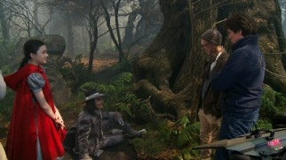 "Rob Marshall directs Lilla Crawford and Johnny Depp on the set of ""Into the Woods."""