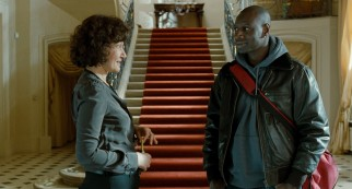 Though out of his element, Driss (Omar Sy) comes to make himself at home in Philippe's stately mansion.