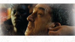 Philippe (François Cluzet) enjoys a bit of auricular stimulation on the Blu-ray's menu.