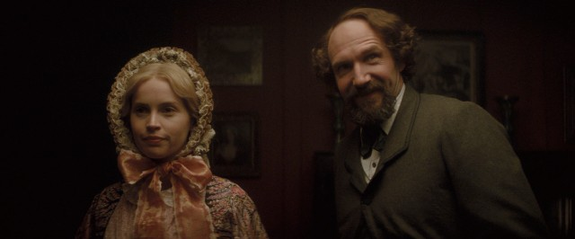 "In ""The Invisible Woman"", Charles Dickens (Ralph Fiennes) becomes romantically involved with Nelly Ternan (Felicity Jones), a significantly younger and not so talented actress."