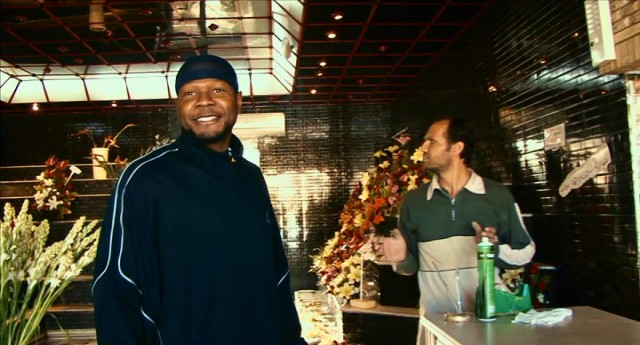 "Pro basketball player Kevin Sheppard goes looking for a Christmas tree with his Afghan super Abdullah in ""The Iran Job."""