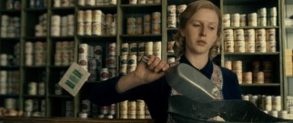 As a young woman, Margaret (Alexandra Roach) works in her father's grocery store.