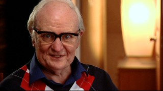 "Jim Broadbent discusses Denis Thatcher, ""The Man Behind the Woman"" he's made up as here."