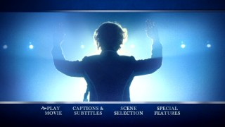 The obligatory behind-the-back in public biopic shot features on The Iron Lady's blue-tinted DVD main menu montage.