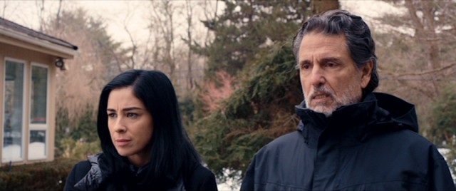 While upstate for Bruce's insurance convention, Laney (Sarah Silverman) pays a visit to her long estranged father (Chris Sarandon).