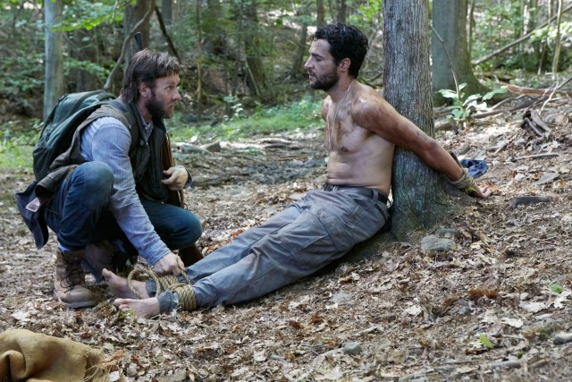 "Paul (Joel Edgerton) questions would-be night thief Will (Christopher Abbott) about his actions and intentions in ""It Comes at Night."""