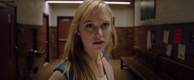 "Jay Height (Maika Monroe) notices she's being followed in ""It Follows."""