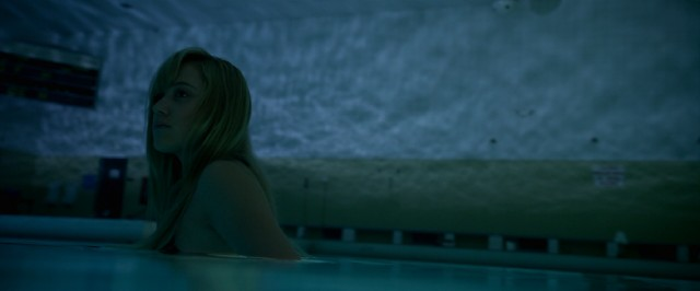 "Jay (Maika Monroe) and friends try to lure ""It"" into a booby-trapped swimming pool in the climax of ""It Follows."""