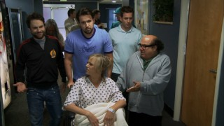 The guys lend their support around Dee as she prepares to give birth.