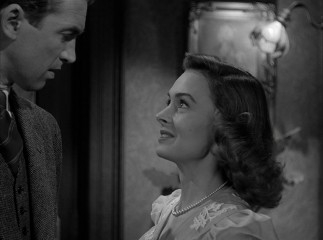 Mary Hatch (Donna Reed) is glad to be visited by her future husband, George Bailey.