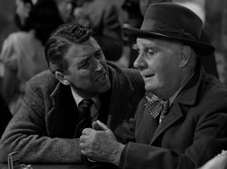 Second-class guardian angel Clarence (Henry Travers) has difficulty blending in with George at Nick's bar.