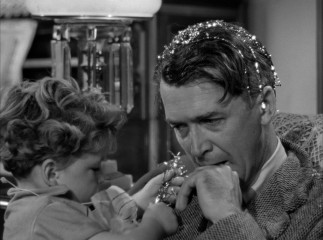 Tinsel in his hair or not, George Bailey (James Stewart) has seen better Christmas Eves.