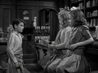 In the original black and white, Little George (Bobbie Anderson) serves 