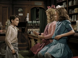 The colorized version allows us to see Little Violet (Jeanine Anne Roose) and Little Mary (Jean Gale) are dressed in pink and blue, respectively.