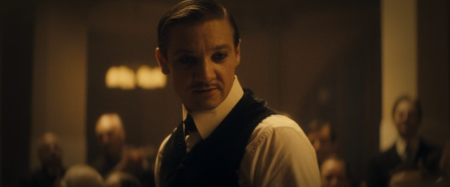 Emil (Jeremy Renner) captivates detained immigrants as Orlando the Magician.