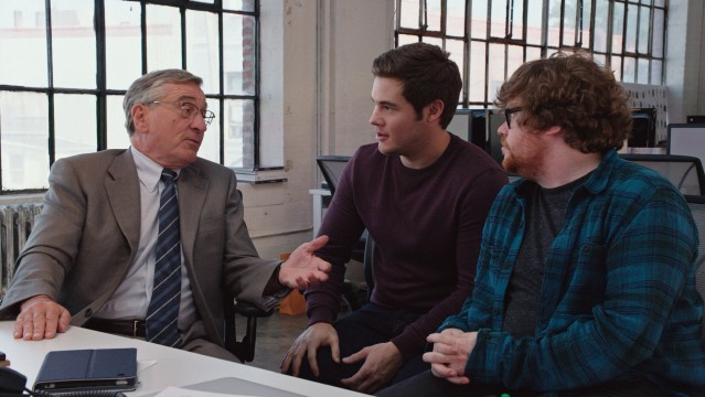 The old guy (Robert De Niro) shares some of his wisdom and experience with his much younger co-workers (Adam DeVine and Zack Pearlman).