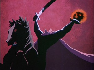 The Headless Horseman rides with a sword in one hand and a glowing head in the other.