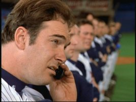 Steady Eddie Everett (Patrick Warburton) takes a cell phone call in the middle of the national anthem.