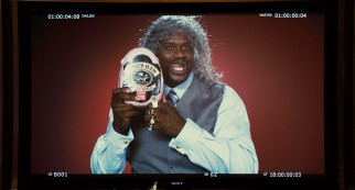 A bewigged Shaquille O'Neal is an enthusiastic spokesman for King's Ham in one of the film's countless celebrity cameos.