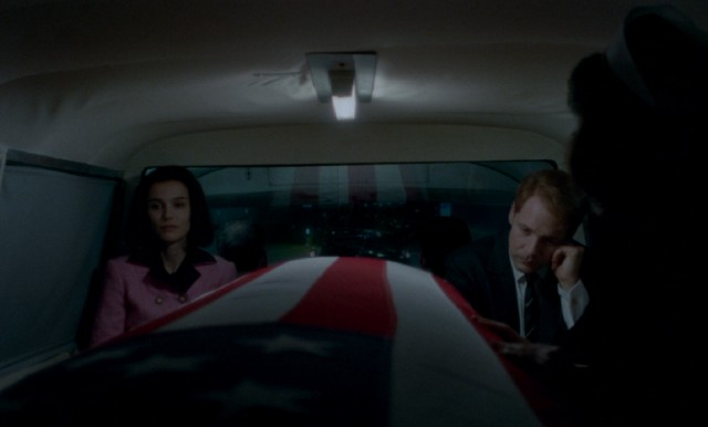Jackie Kennedy (Natalie Portman) and Robert Kennedy (Peter Sarsgaard) sit in silence while riding along with the casket holding assassinated president John F. Kennedy, her husband and his brother.