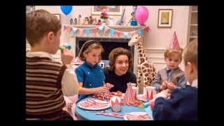 Jackie's social secretary Nancy Tuckerman (Greta Gerwig) oversees her son's birthday party in this photo gallery still.